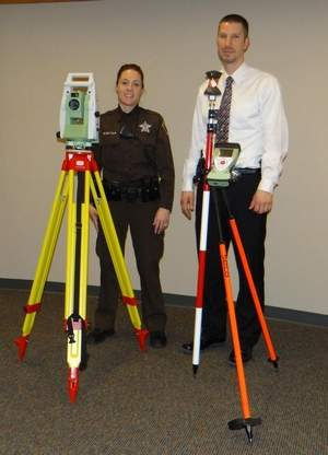Dodge County Crash Investigation Team members Deputy Jaime Buelter, left, and Detective Ted Sullivan train on the newly acquired robotic total station that will help officers collect evidence at crime/crash scenes more quickly and with less manpower. Image Source: fdlreporter