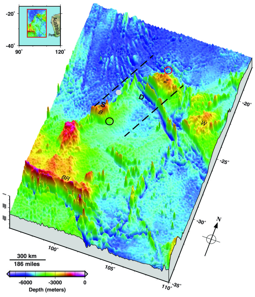 Seafloor topography in the Malaysia Airlines flight MH370 search area. Dashed lines approximate the search zone for sonar pings emitted by the flight data recorder and cockpit voice recorder popularly called black boxes. The first sonar contact (black circle) was reportedly made by a Chinese vessel on the east flank of Batavia Plateau (B), where the shallowest point in the area (S) is at an estimated depth of 1637 meters. The next reported sonar contact (red circle) was made by an Australian vessel on the north flank of Zenith Plateau (Z). The deepest point in the area (D) lies in the Wallaby-Zenith Fracture Zone at an estimated depth of 7883 meters. The Wallaby Plateau (W) lies to the east of the Zenith Plateau. The shallowest point in the entire area shown here is on Broken Ridge (BR). Deep Sea Drilling Project (DSDP) site 256 is marked by a gray dot. The inset in the top left shows the area's location to the west of Australia. Seafloor depths are from the General Bathymetric Chart of the Oceans [2010]. Credit: Walter H.F. Smith and Karen M. Marks
