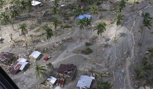This photo released by the Philippine Army's 10th Infantry Division on Thursday shows an aerial view of houses damaged by flashfloods caused by Typhoon Pablo in Compostela Valley province. (AP photo)