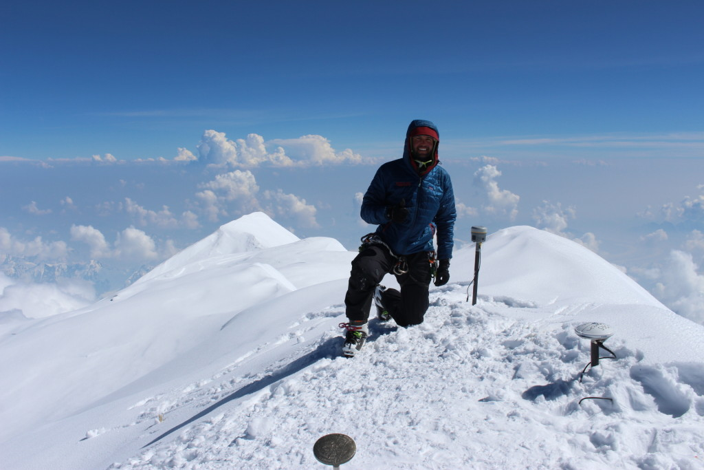 On top of North America! Blaine Horner from CompassData poses with GPS equipment on the top of Mount McKinley. (Photo: Agustin Karriere, CompassData)