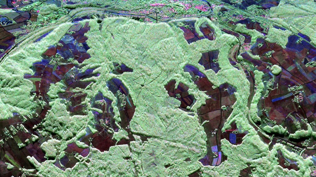 Traunstein Forest - F-SAR Image Polarimetric radar image of the test area near Traunstein, in southeast Bavaria, acquired up by F-SAR sensor in L-band on 30 Jun 2015. The image is shown in false in colours; forest areas appear in green; surfaces with low vegetation areshown inn blue/red.  Credit: DLR
