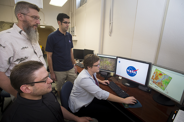Idaho State University / NASA team in GIS Center, from left, sitting, Zachery Simpson, and Jenna Williams; standing, Keith Weber and Jeff May. Photo credit: ISU