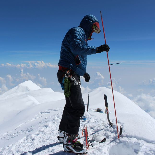 Blaine Horner of CompassData probing the snow pack at the highest point in North America along with setting up Global Position System equipment for precise summit elevation data. (Photo: Blaine Horner, CompassData)