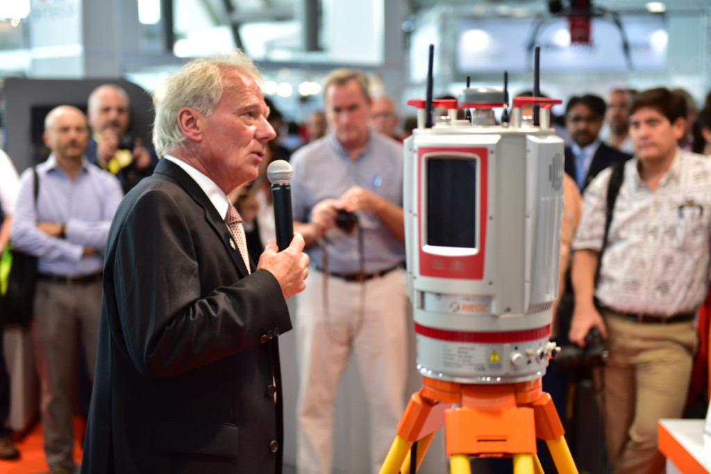 Attracting a lot of attention: Dr. Riegl, CEO, unveiling new RIEGL VZ-400i 3D Terrestrial Laser Scanner at the RIEGL Intergeo booth in Stuttgart