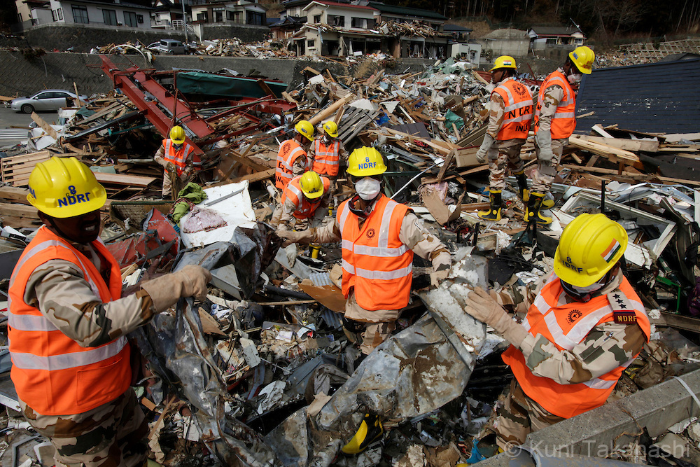Members of National Disaster Relief Force (NDRF) of India search bodies in Onagawa, Miyagi, Japan on April 2, 2011 after massive earthquake and tsunami hit northern Japan. More than 10,000 were killed and more than 17,000 are still missing by the disaster hit on March 11. Forty six members of NDRF were deployed to Japan to help discovery effort. Photo by Kuni Takahashi