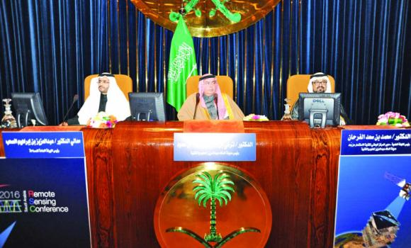 KACST President Prince Turki bin Saud bin Mohammed Al-Saud, center, is flanked by chairman of the scientific committee of the conference Mohamed Al-Farhan, right , and Saad Al-Hamlan from the General Commission of Survey at the conference. Credit: Arab News