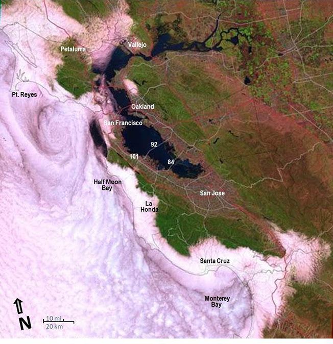 This Landsat image of May 22, 1991 shows the marine stratus and stratocumulus cloud layer that moved into the San Francisco Bay-Delta and Monterey Bay. Several cloud patterns can be seen in this image: the eddy-like spiral to the west of the Golden Gate, the darker linear cloud feature that parallels the coast down to Monterey Bay, and fog funneling from Monterey Bay inland.