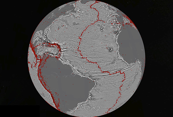 North Atlantic (vertical gravity gradient) Marine gravity model of the North Atlantic (10 mGal contours). Red dots show locations of earthquakes with magnitude > 5.5 and they highlight the present-day location of the seafloor spreading ridges and transform faults. This gravity information shows the details of the plate tectonic history of the rifting of these continents including the subtle signatures of fracture zones that are currently buried by sediment.
