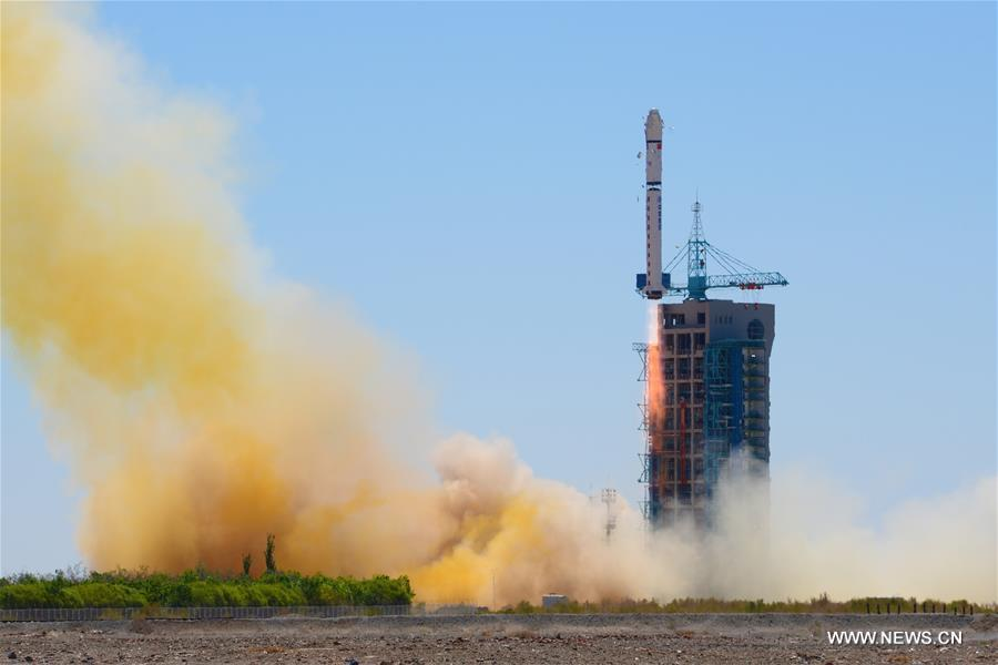 A Long March 2-D rocket carrying the Yaogan-30 remote sensing satellite blasts off.