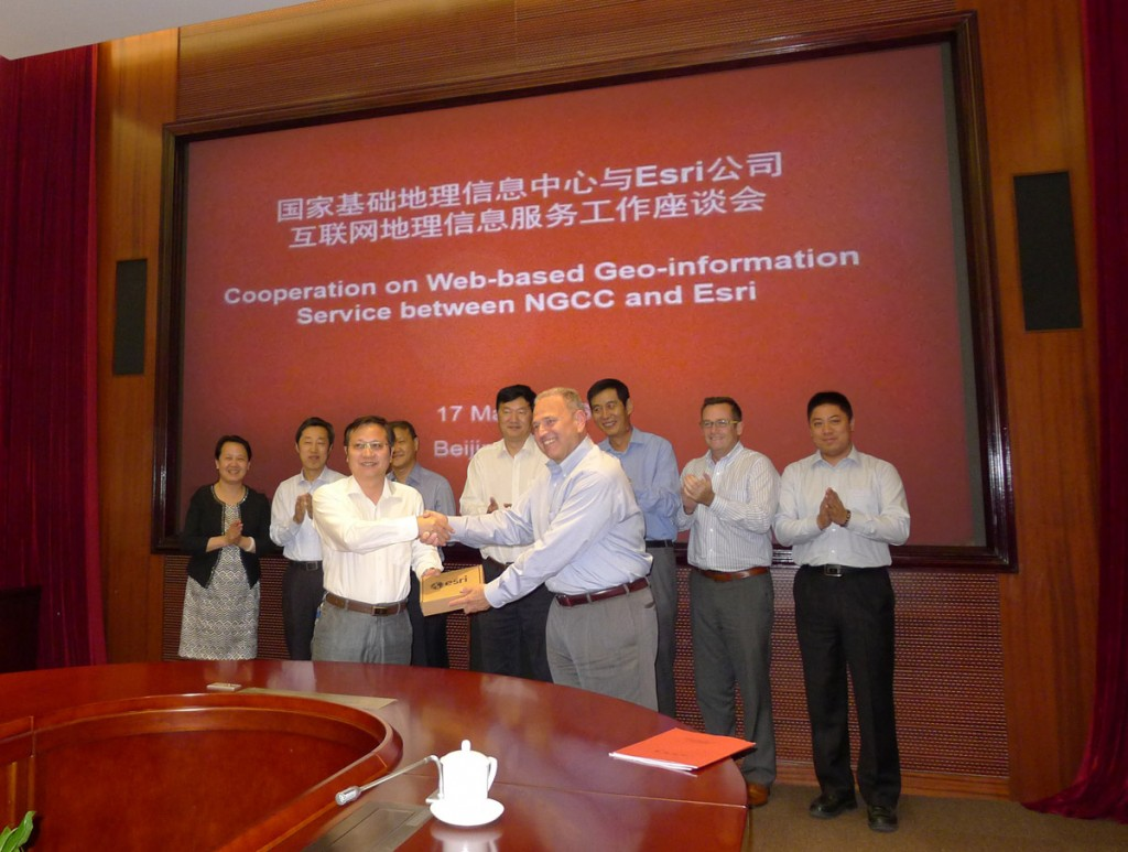 Dean Angelides, director, International Operations, Esri, and Feng Xianquang, director for NGCC, signed the historic agreement to share data with users around the world. Credit: Esri