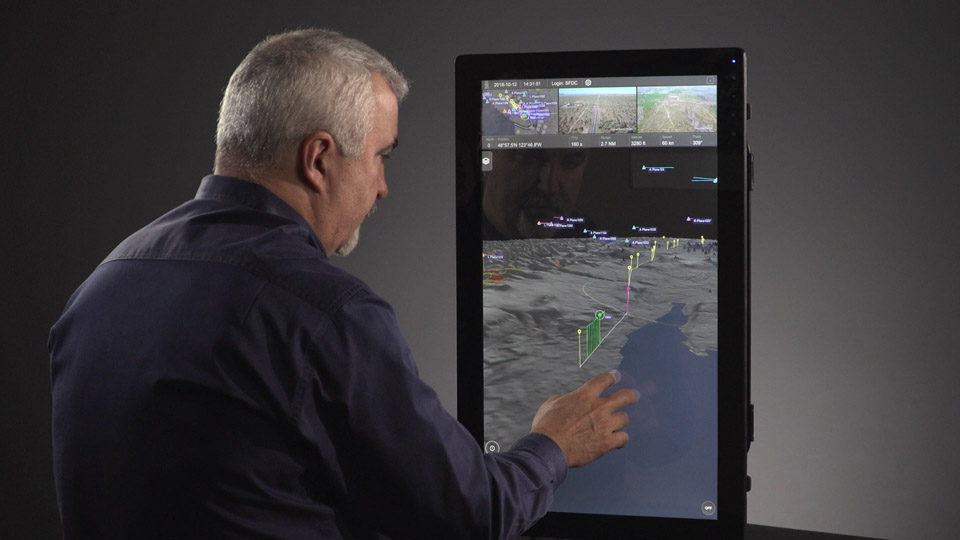 Program director Paige Cutland uses IRIS UAS software. The best-in-class IRIS UAS situational awareness display will include airspace safety and efficiency services powered by the AirMap airspace management platform