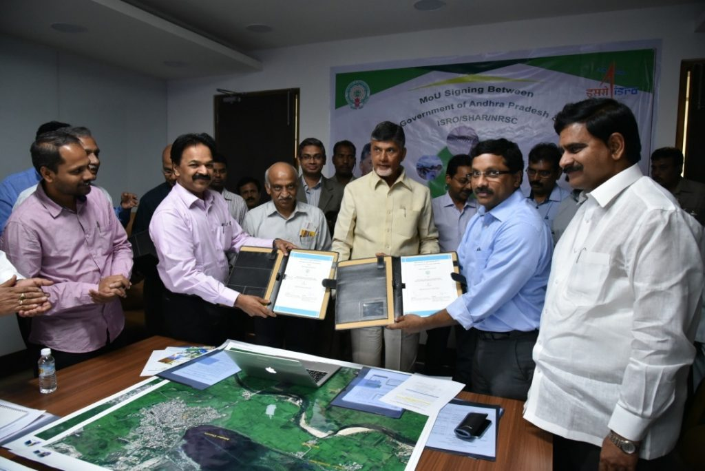 Director, SDSC SHAR /ISRO and Special Chief Secretary to Government (FAC) (Marketing), Govt. of Andhra Pradesh exchanging MoU in the presence of Hon'ble Chief Minister of Andhra Pradesh and Chairman, ISRO on March 15, 2017 at Vijayawada