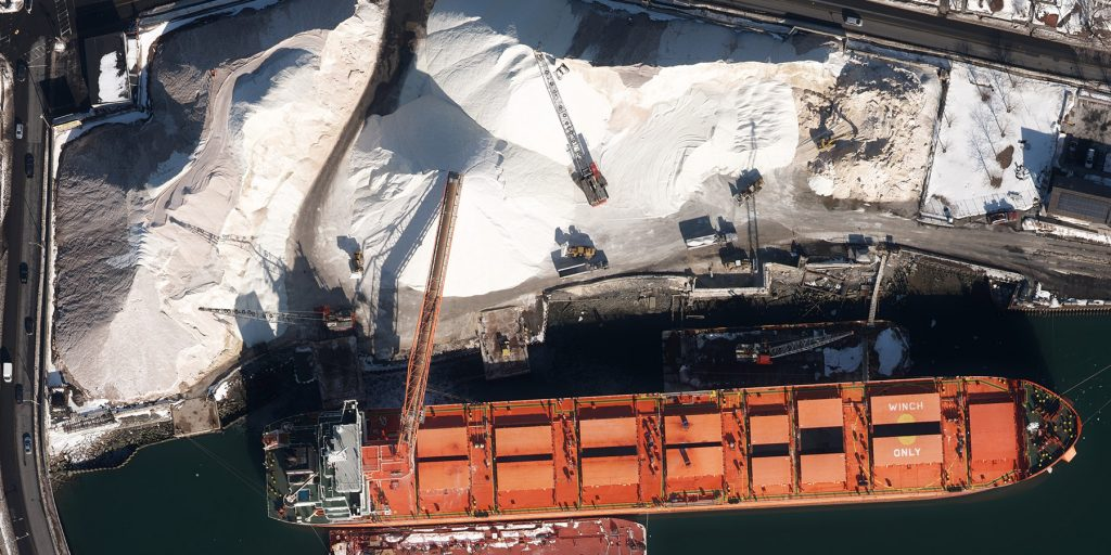 Aerial Imagery -Aerial image of salt being unloaded from ship at the Chelsea Docks in New York Harbor.